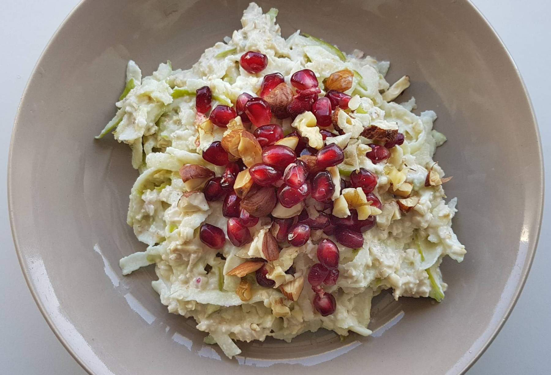 Home-made bircher muesli with apple, almonds and pomegranate